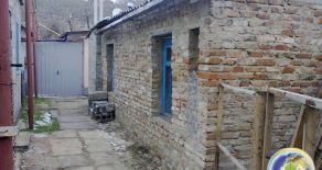 Частина будинку у центрі міста по вул. Комунарів